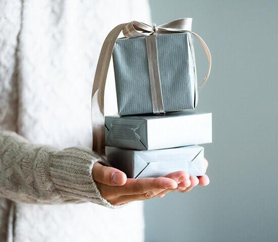a woman holding a beautiful gift box
