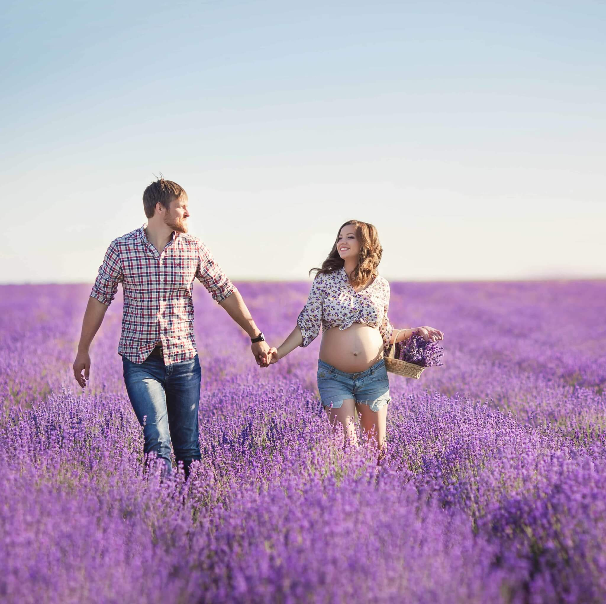 A couple having a walk in a lush field of lavender